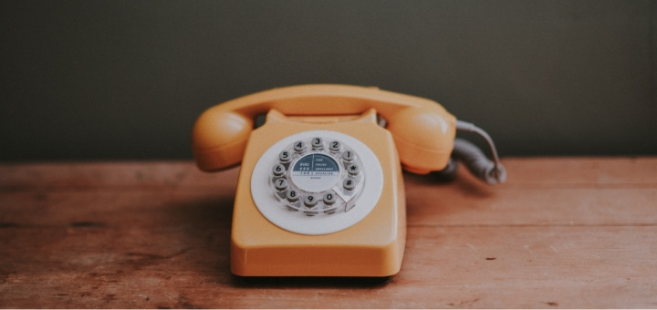 a yellow telephone from the 1970s/80s
