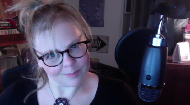 Eve in front of the podcast mic
