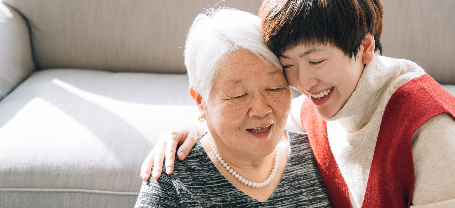 A grown daughter with elderly mother